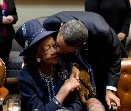 President Barack Obama kisses Dr. Dorothy Height during a meeting on Martin Luther King Jr. Day in the Roosevelt Room of the White House, Jan. 18, 2010. President Obama met with a group of African American seniors and their grandchildren on the legacy of the civil rights movement. (Official White House photo by Pete Souza)This official White House photograph is being made available only for publication by news organizations and/or for personal use printing by the subject(s) of the photograph. The photograph may not be manipulated in any way and may not be used in commercial or political materials, advertisements, emails, products, promotions that in any way suggests approval or endorsement of the President, the First Family, or the White House.