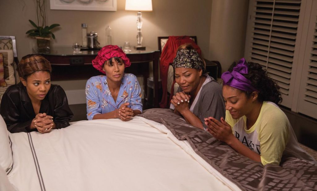 "In ""Girls Trip,"" when four lifelong friends—(L to R) Ryan (REGINA HALL), Lisa (JADA PINKETT SMITH), Sasha (QUEEN LATIFAH) and Dina (TIFFANY HADDISH)—travel to New Orleans for the annual ""Essence"" Festival, sisterhoods are rekindled, wild sides are rediscovered, and there's enough dancing, drinking, brawling and romancing to make the Big Easy blush."